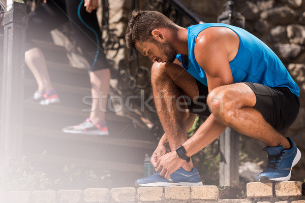sportsman tying shoelaces  Stock photo © LightFieldStudios