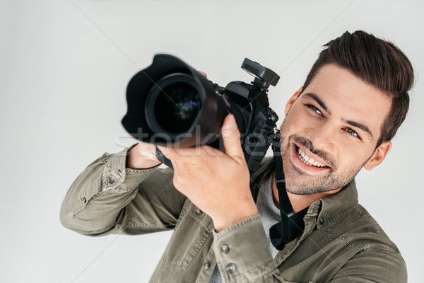 smiling photographer with digital camera Stock photo © LightFieldStudios