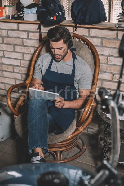 mechanic with tablet and headphones Stock photo © LightFieldStudios
