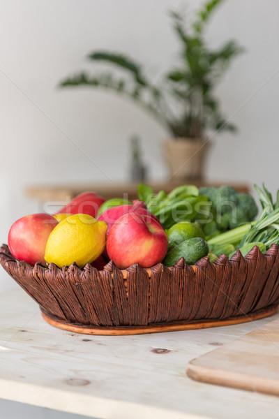 Gyümölcsök zöldségek kosár szelektív fókusz friss fa asztal Stock fotó © LightFieldStudios