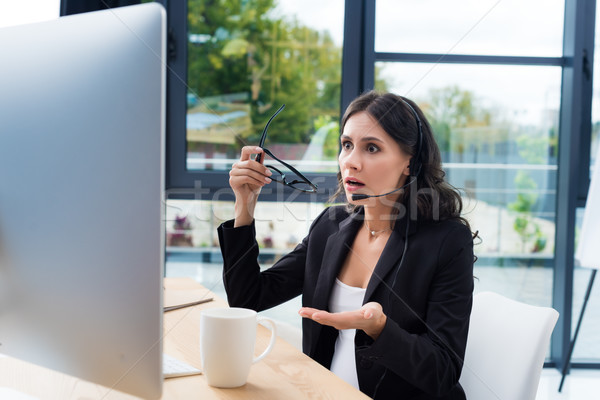 Megrémült terhes üzletasszony headset ügyfélszolgálat munkahely Stock fotó © LightFieldStudios