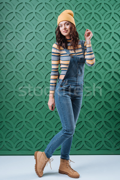 Woman posing in pullover, hat and overalls Stock photo © LightFieldStudios