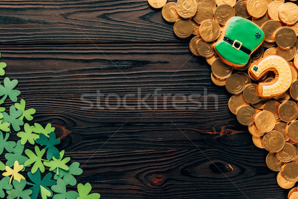 top view of shamrock and golden coins on wooden table, st patricks day concept Stock photo © LightFieldStudios