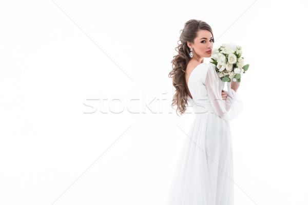 Novia posando vestido blanco ramo de la boda aislado blanco Foto stock © LightFieldStudios