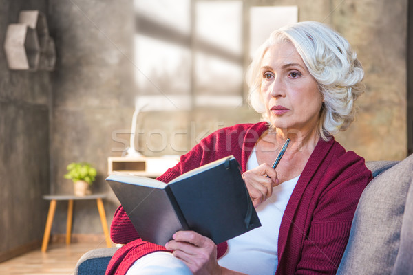 Woman making notes Stock photo © LightFieldStudios