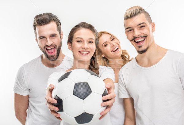 Cheerful friends with soccer ball Stock photo © LightFieldStudios