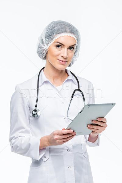 Doctor holding digital tablet Stock photo © LightFieldStudios