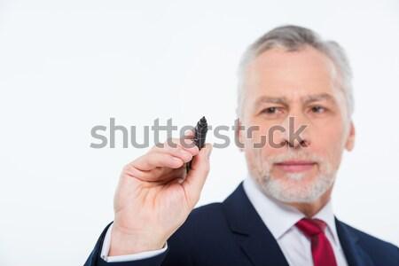 ビジネスマン 書く マーカー ハンサム 成熟した 黒 ストックフォト © LightFieldStudios