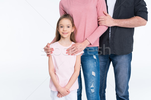 Cropped shot of young family with one child standing together on white Stock photo © LightFieldStudios