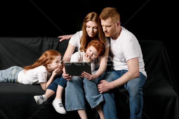 family using digital tablet isolated on black Stock photo © LightFieldStudios