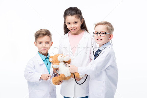 Kids playing doctors Stock photo © LightFieldStudios