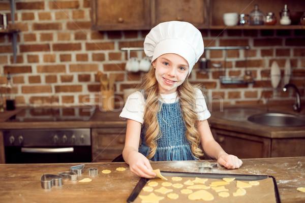 Portré kislány szakács sapka készít alakú sütik Stock fotó © LightFieldStudios