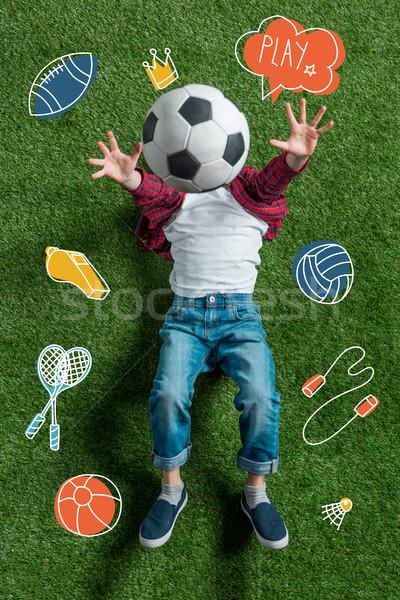 Ragazzo soccer ball top view testa erba verde Foto d'archivio © LightFieldStudios