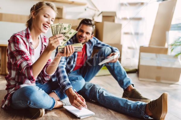 young couple counting money Stock photo © LightFieldStudios
