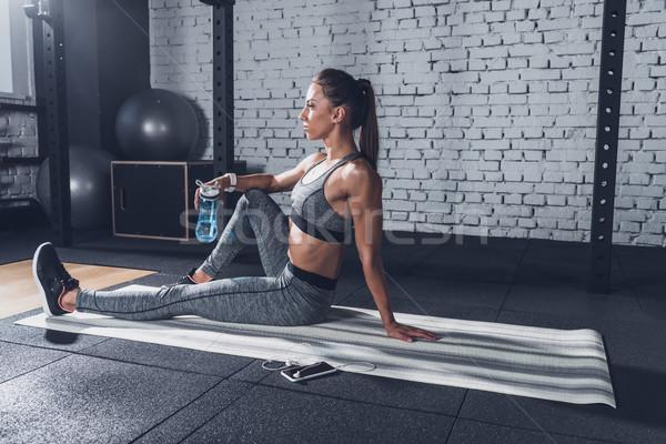 woman with sportive water bottle Stock photo © LightFieldStudios