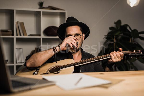 Mal sucedido músico potável sozinho jovem local de trabalho Foto stock © LightFieldStudios