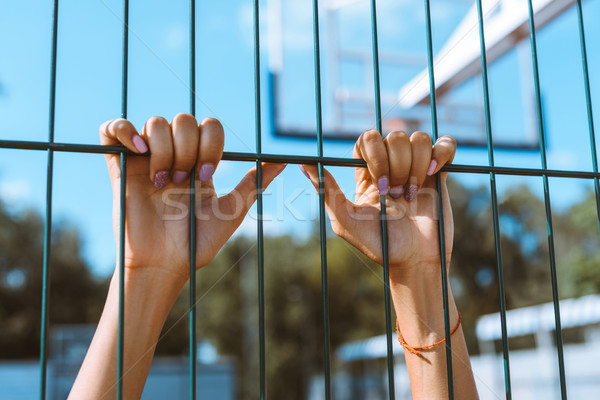 hands clinging onto fencing Stock photo © LightFieldStudios