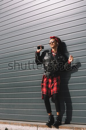 girl in leather jacket and sunglasses Stock photo © LightFieldStudios