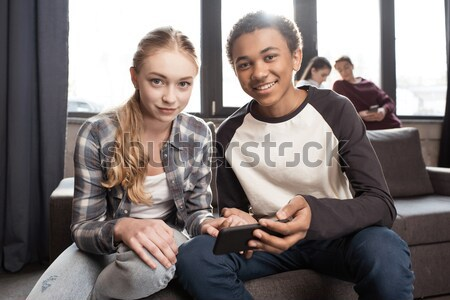 multicultural couple with drinks Stock photo © LightFieldStudios
