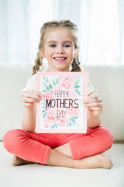smiling girl showing happy mother's day postcard in hands, mother's day concept Stock photo © LightFieldStudios