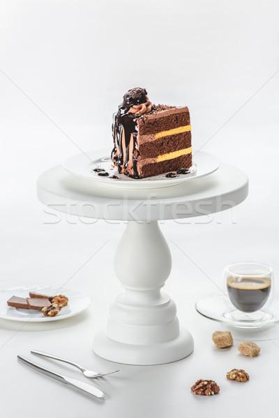 piece of chocolate cake on white cake stand Stock photo © LightFieldStudios