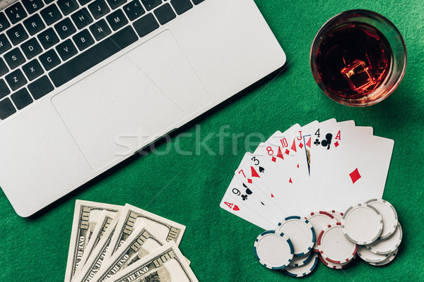 Laptop kocka hazárdjáték sültkrumpli billentyűzet pénz Stock fotó © LightFieldStudios