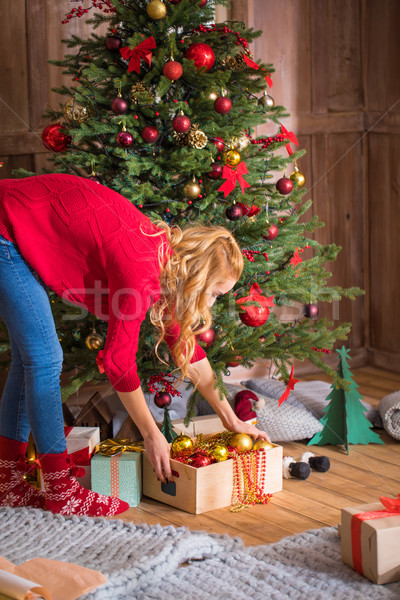 Woman decorating christmas tree  Stock photo © LightFieldStudios