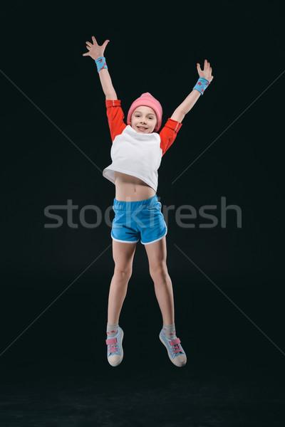 улыбаясь девушки прыжки изолированный черный Сток-фото © LightFieldStudios