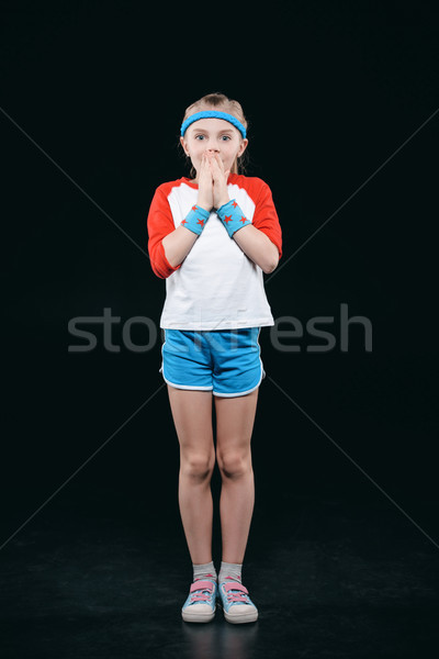 Shocked little girl in sportswear standing and looking at camera, activities for children concept    Stock photo © LightFieldStudios