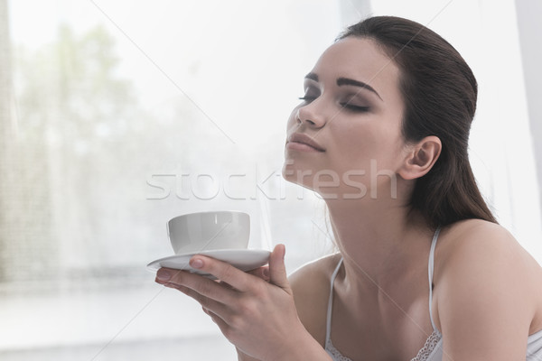 woman with cup of coffee Stock photo © LightFieldStudios