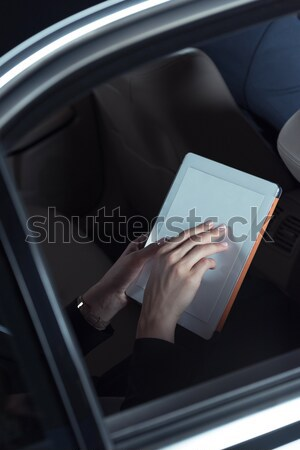 woman using digital tablet in car Stock photo © LightFieldStudios