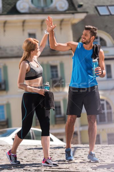 Sportok pár sportos sportoló sportoló jogging Stock fotó © LightFieldStudios