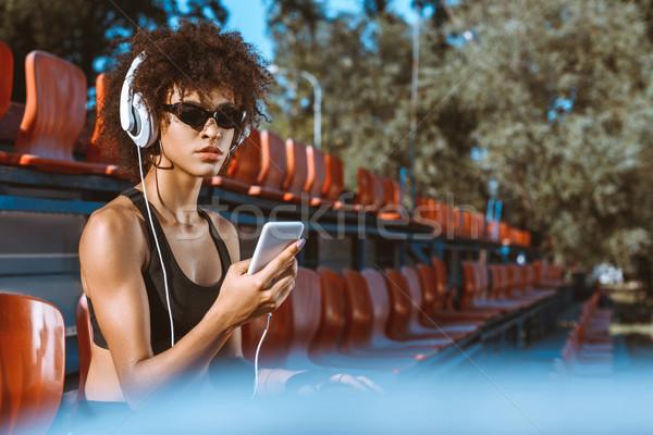 спортивный женщину наушники молодые Сток-фото © LightFieldStudios