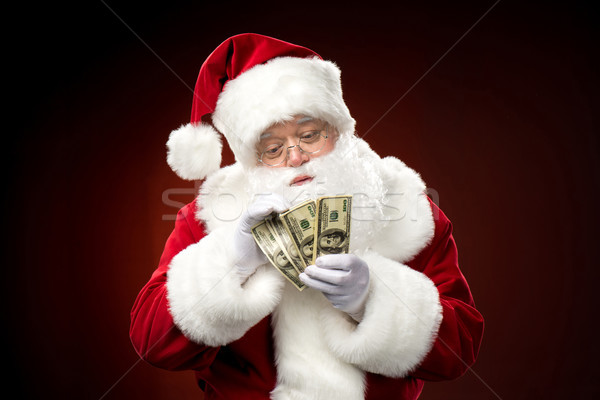 Santa Claus counting dollar banknotes Stock photo © LightFieldStudios