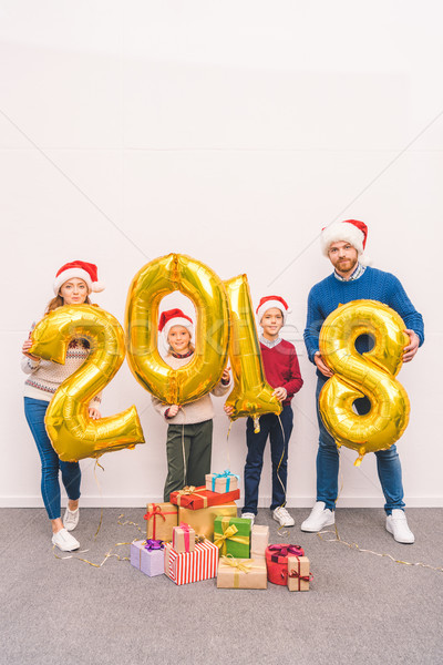 family holding new year balloons Stock photo © LightFieldStudios