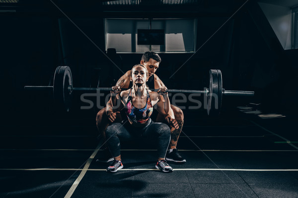 sportswoman lifting barbell Stock photo © LightFieldStudios