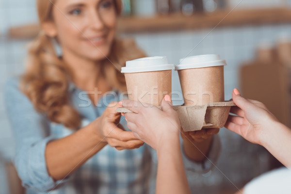 waitress holding disposable coffee cups Stock photo © LightFieldStudios