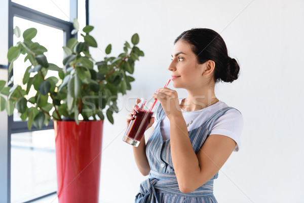 thoughtful woman with detox drink Stock photo © LightFieldStudios