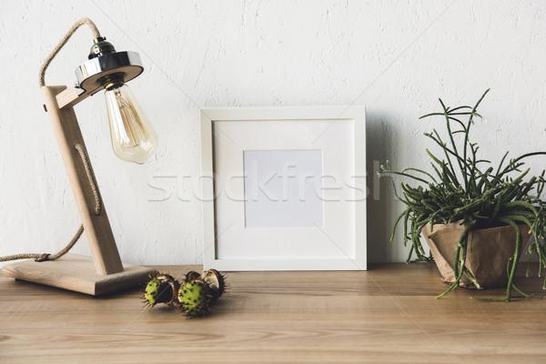 empty photo frame at workplace Stock photo © LightFieldStudios