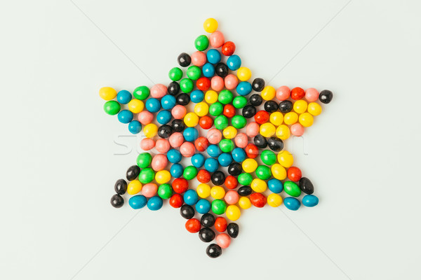 top view of star made of sweets isolated on grey, purim holiday concept Stock photo © LightFieldStudios