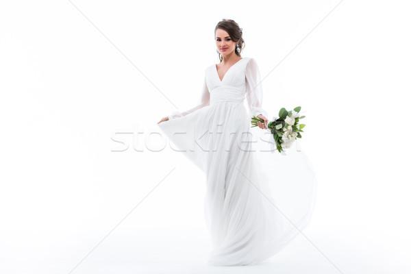 Atractivo novia posando vestido blanco ramo de la boda aislado Foto stock © LightFieldStudios