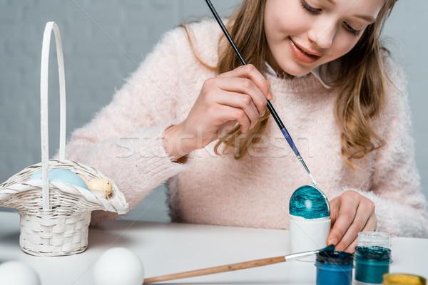 cropped shot of cute smiling girl painting easter egg  Stock photo © LightFieldStudios