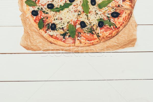 Italian pizza with olives on white wooden background Stock photo © LightFieldStudios