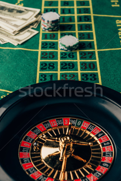 Casino table with roulette and placed chips Stock photo © LightFieldStudios