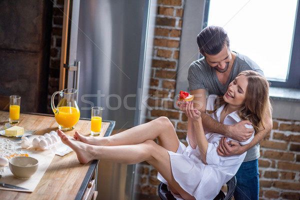 Couple with strawberry cake  Stock photo © LightFieldStudios