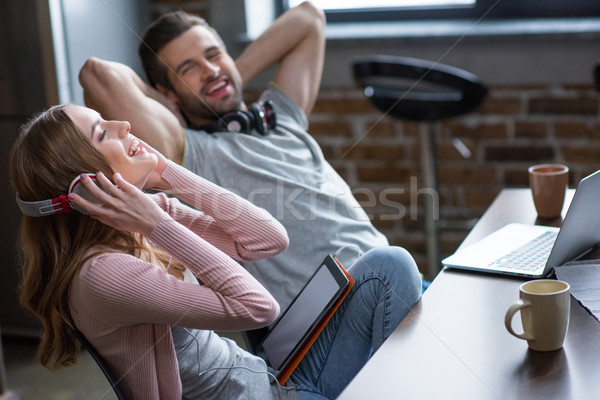 Couple using devices Stock photo © LightFieldStudios