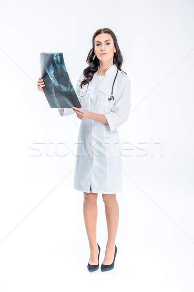 Doctor holding x-ray image Stock photo © LightFieldStudios
