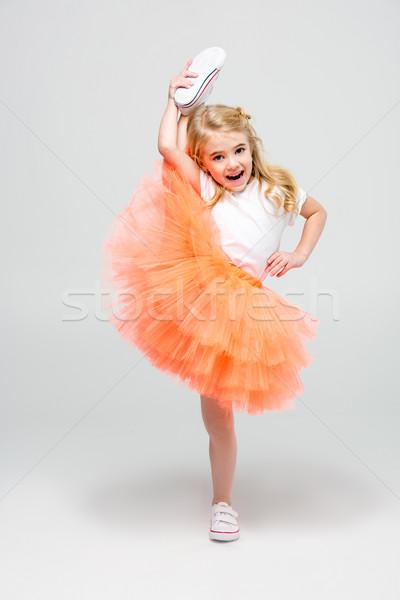 Girl making stretching trick Stock photo © LightFieldStudios