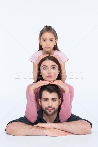 Töprengő fiatal család egy gyermek néz Stock fotó © LightFieldStudios