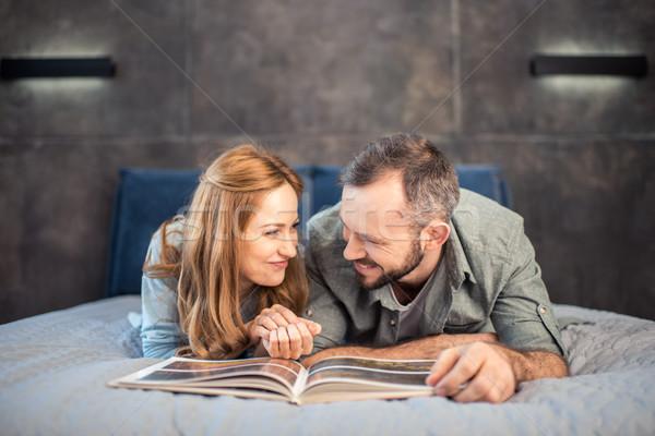 Couple reading on bed Stock photo © LightFieldStudios